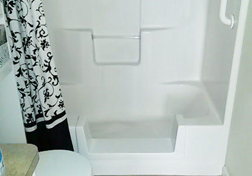 Converted fiberglass surround tub